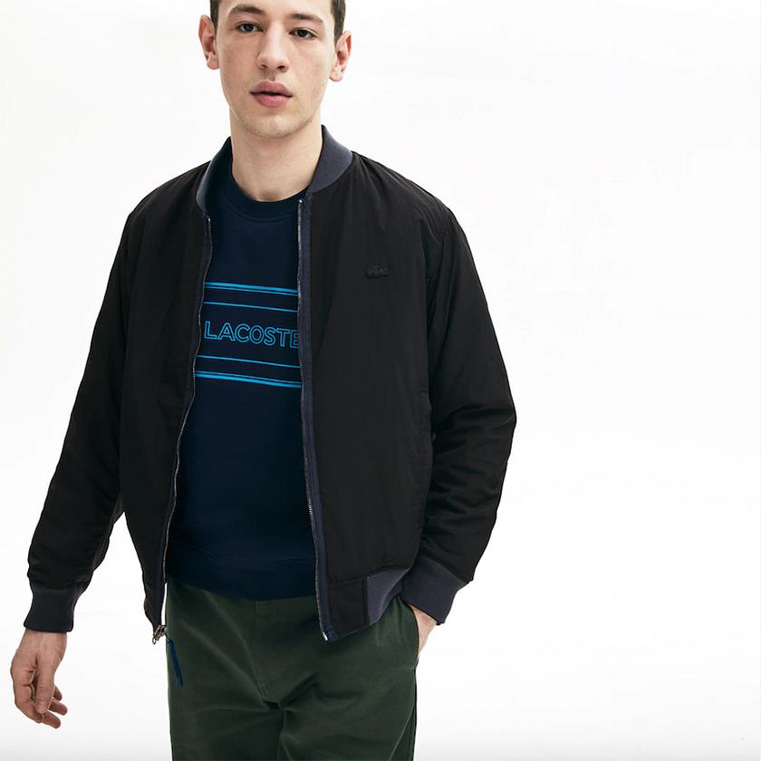 Lacoste chaqueta reversibe azul marino negro